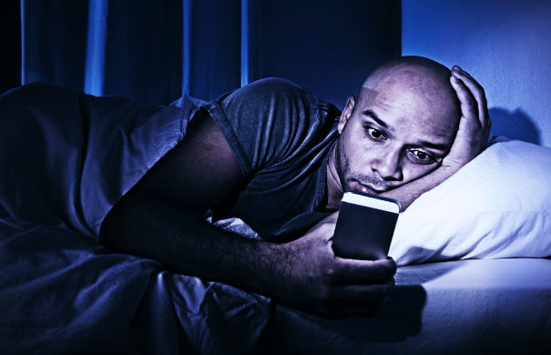 bigstock-Young-Cell-Phone-Addict-Man-Aw-74103901