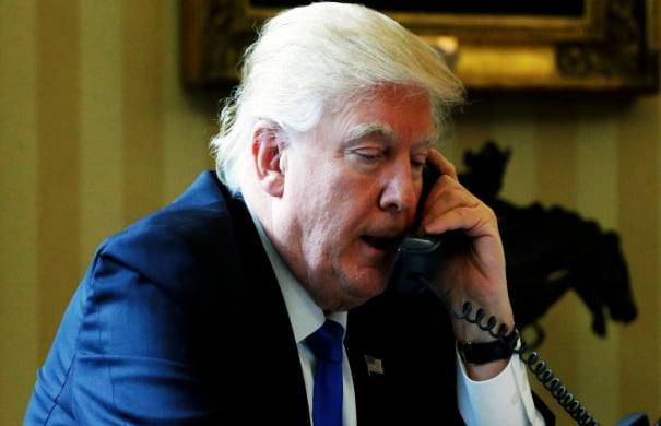 U.S. President Donald Trump speaks by phone with Russia's President Vladimir Putin in the Oval Office at the White House in Washington, U.S. January 28, 2017. REUTERS/Jonathan Ernst