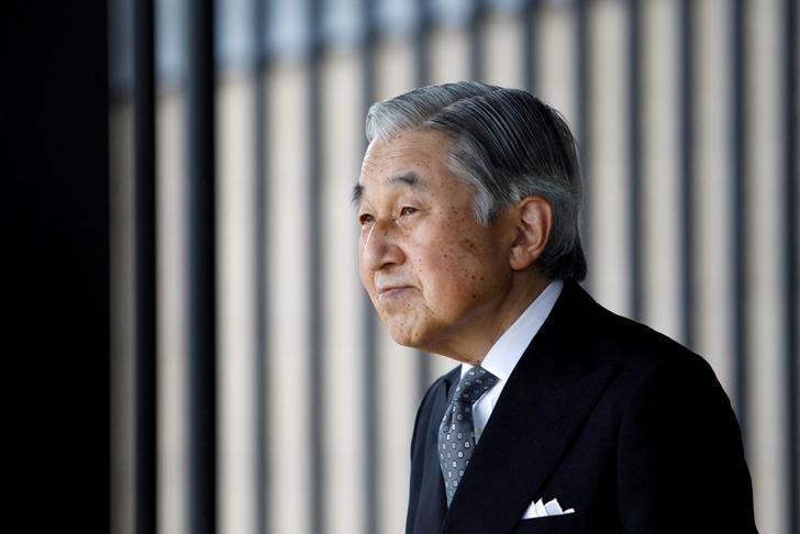 Japan's Emperor Akihito waits for the arrival of German President Christian Wulff at the Imperial Palace in Tokyo