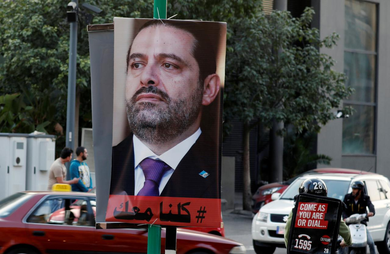A poster depicting Saad al-Hariri, who announced his resignation as Lebanon's prime minister from Saudi Arabia, is seen in Beirut