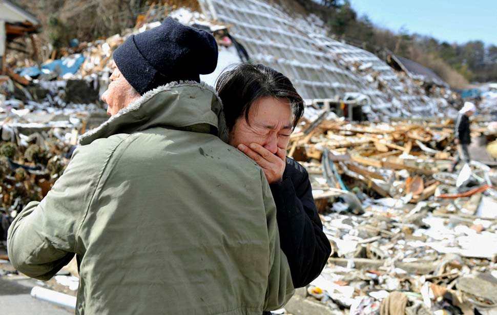 A woman cries after her mother's body was found in Onagawa, Miyagi prefecture