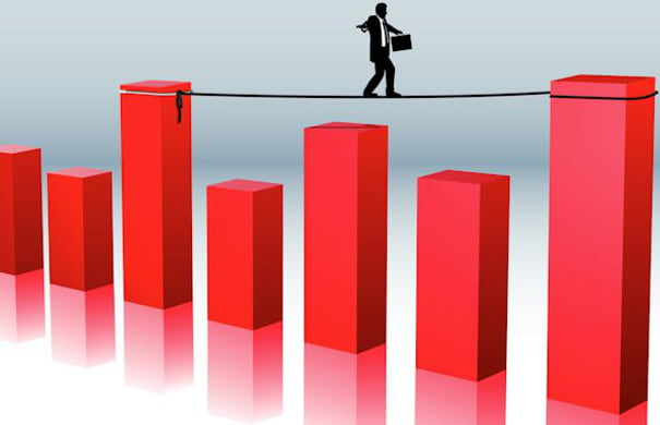 business man and the balancing act of financial risk