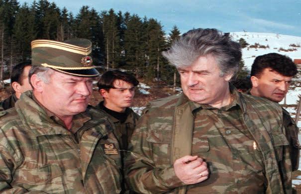 File photo of former Bosnian Serb wartime leader Karadzic talking to his general Mladic on the central Bosnian Mt Vlasic