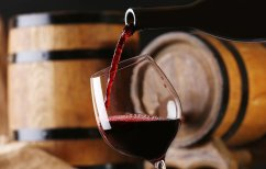 bigstock-Pouring-red-wine-from-bottle-i-90032456